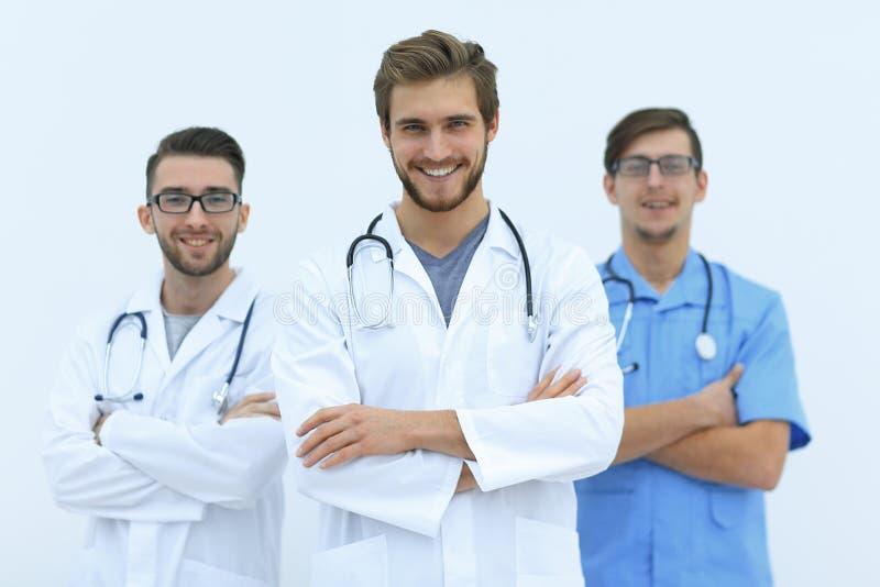 Equipe amigável de doutores bem sucedidos Isolado no branco fotos de stock
