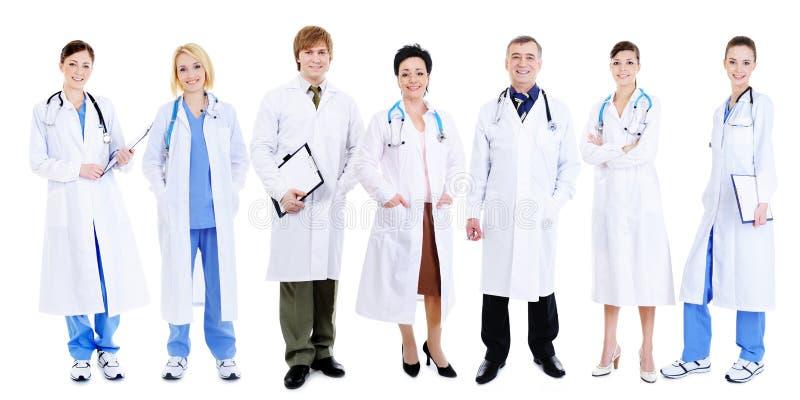 Equipe de doutores de riso felizes imagens de stock