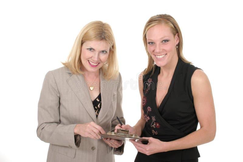 Equipe de duas mulheres 1 do negócio fotos de stock royalty free