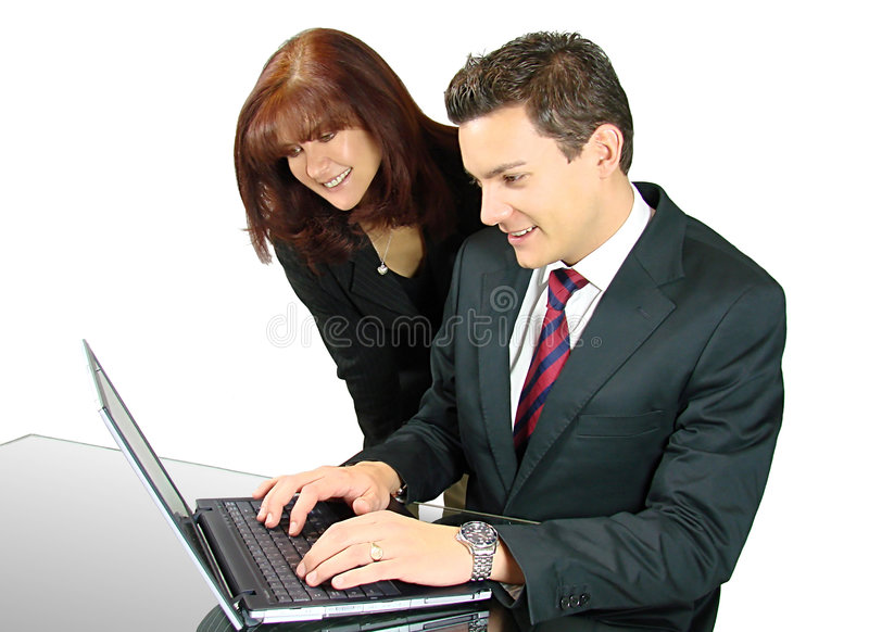 Equipe do negócio com um portátil imagens de stock royalty free