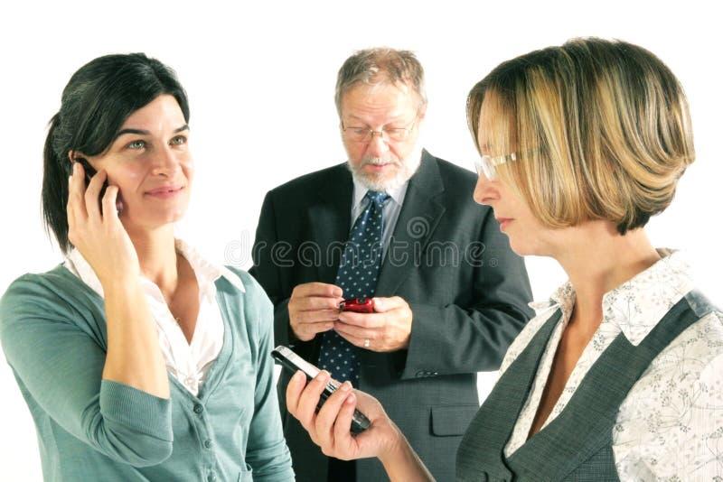 Equipe do negócio no móbil fotografia de stock