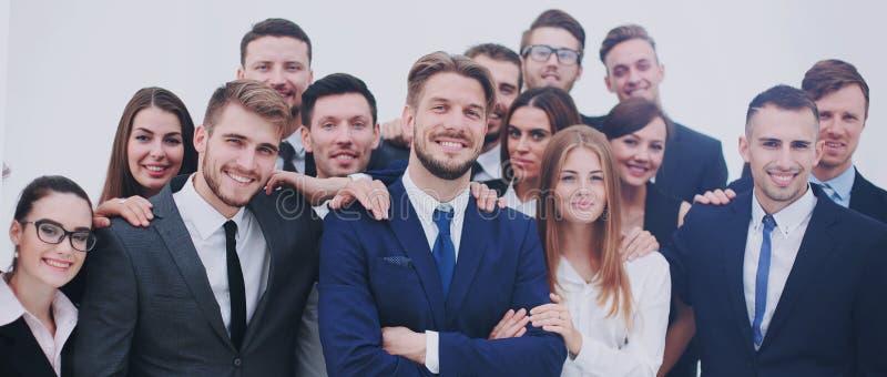 A equipe dos povos bem sucedidos com seu chefe imagem de stock