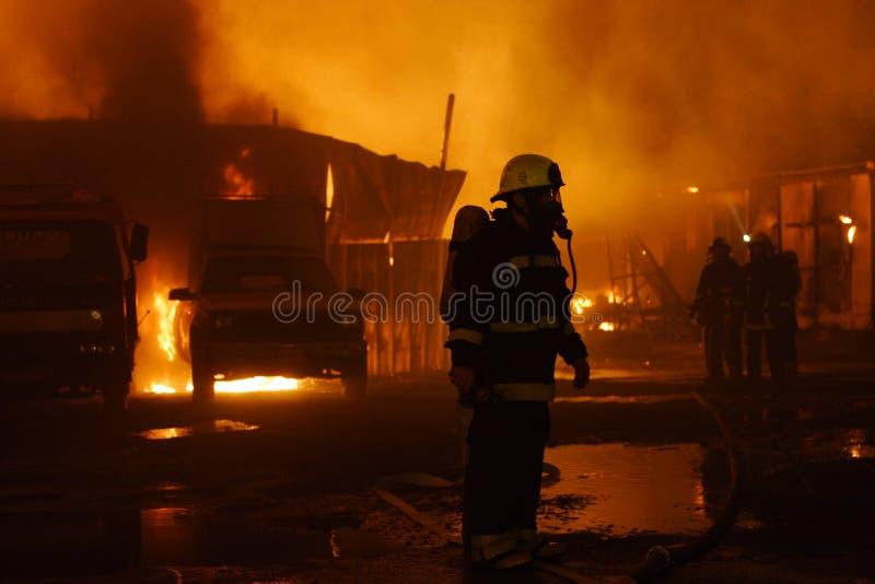 Equipe dos sapadores-bombeiros imagem de stock