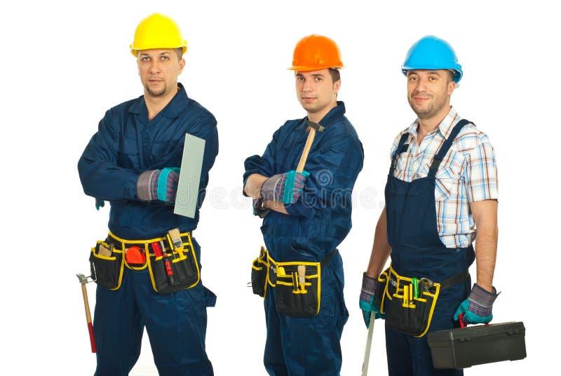Equipe dos trabalhadores do construtor imagens de stock royalty free