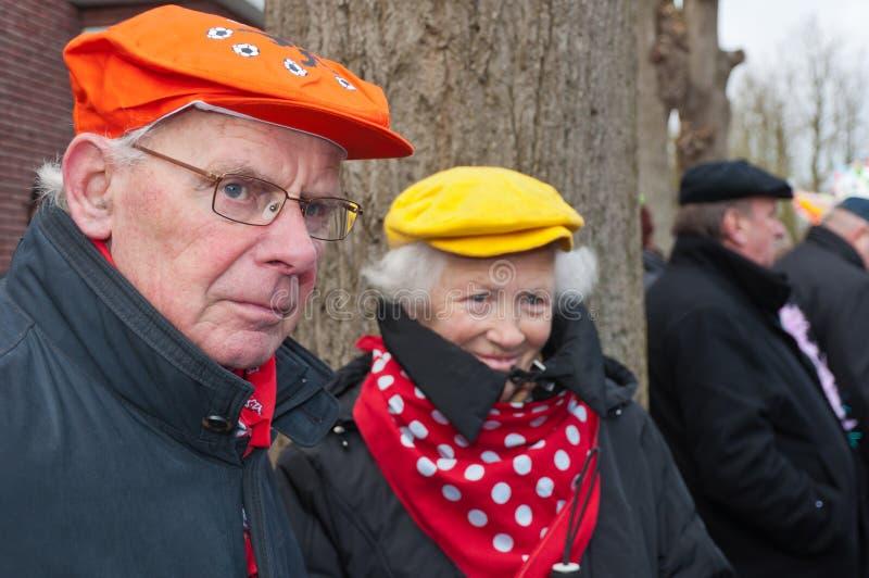 Equipe e seu relógio da esposa a parada de carnaval. foto de stock royalty free