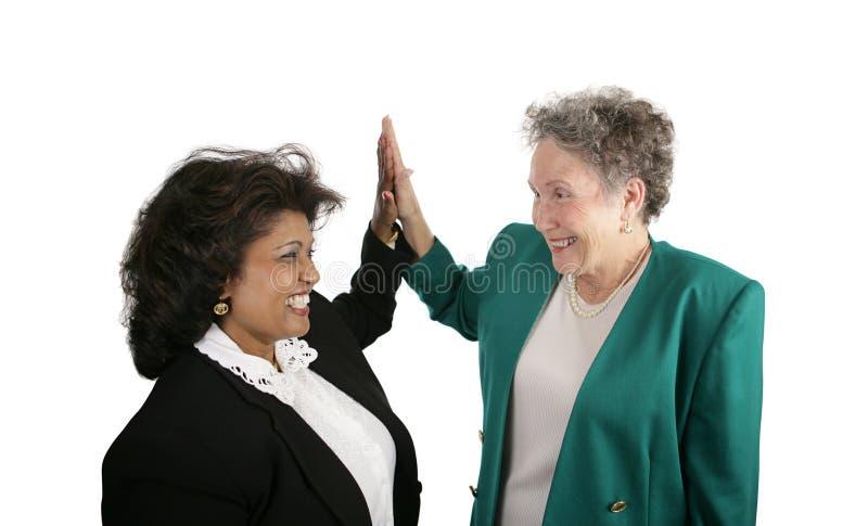Equipe fêmea do negócio - cinco elevados foto de stock royalty free