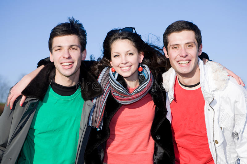 Equipe feliz dos jovens do riso imagem de stock