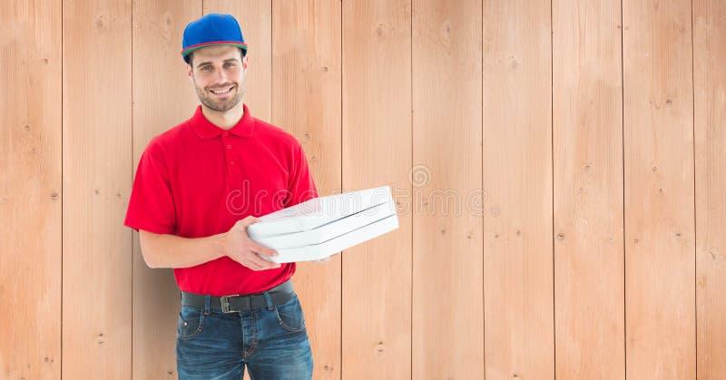 Equipe guardar as caixas da pizza que estão contra o assoalho de folhosa ilustração royalty free