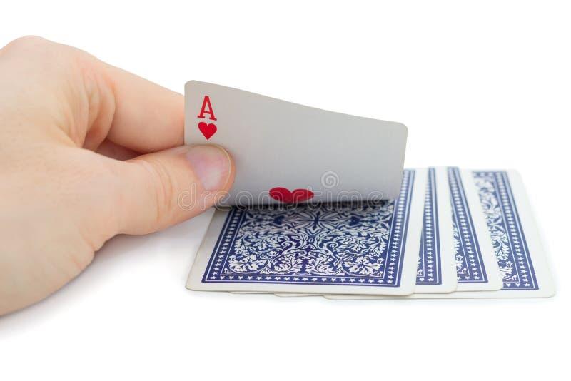 Equipe guardar e espreitar um cartão de jogo (o ás de corações) fotografia de stock