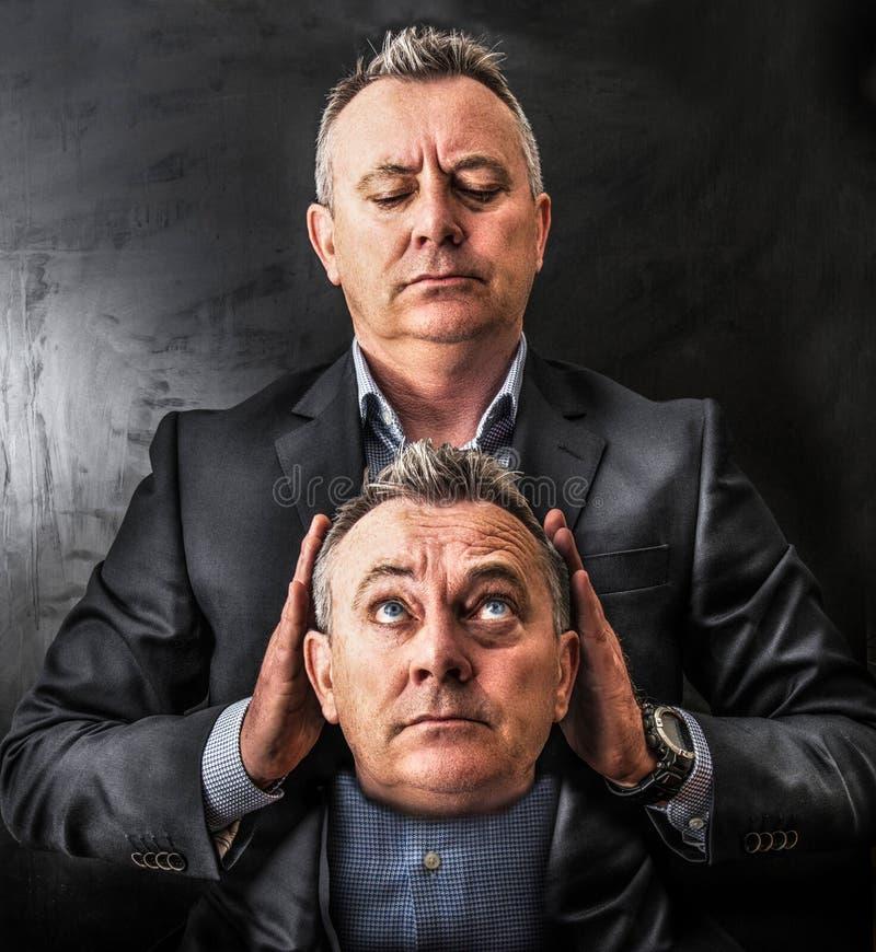 Equipe guardar para possuir a cabeça em suas mãos fotografia de stock royalty free