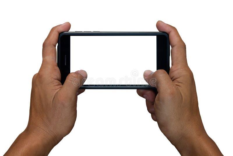 Equipe a mão que guarda e que usa o móbil, telefone celular, telefone esperto com a tela isolada no fundo branco foto de stock