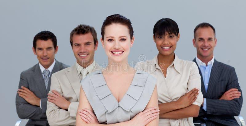 Equipe Multi-ethnic do negócio com braços dobrados fotografia de stock