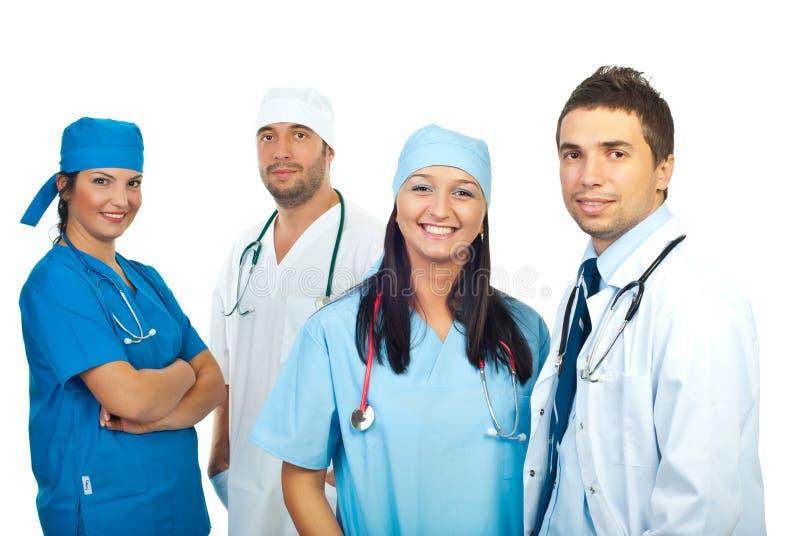 Equipe nova de sorriso amigável dos doutores foto de stock