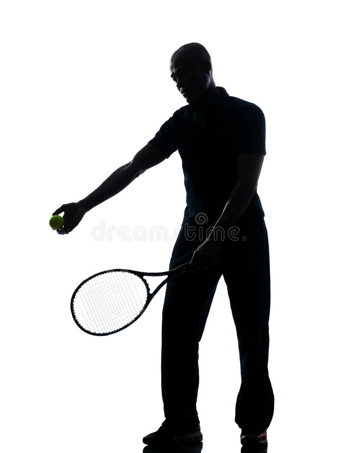 Equipe o jogador de ténis no serviço imagem de stock