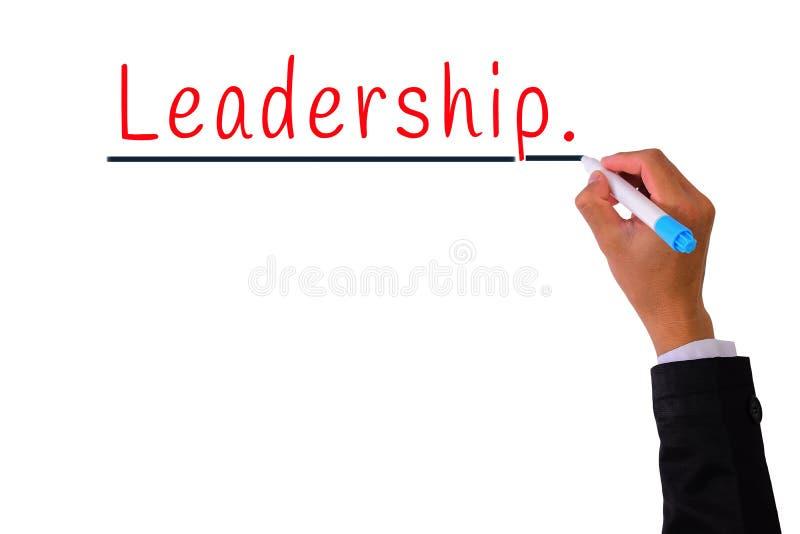 equipe o marcador da pena de terra arrendada da mão e escreva a palavra da liderança isolada no branco, conceito do negócio fotografia de stock royalty free