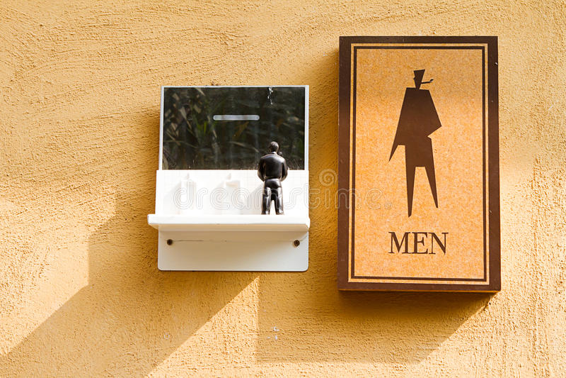 Equipe o sinal do toalete foto de stock