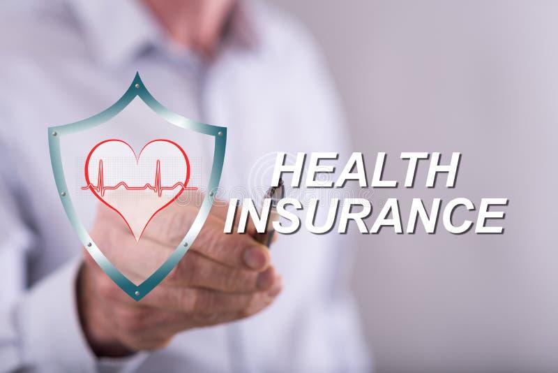 Equipe o toque de um conceito do seguro de saúde em um tela táctil imagens de stock