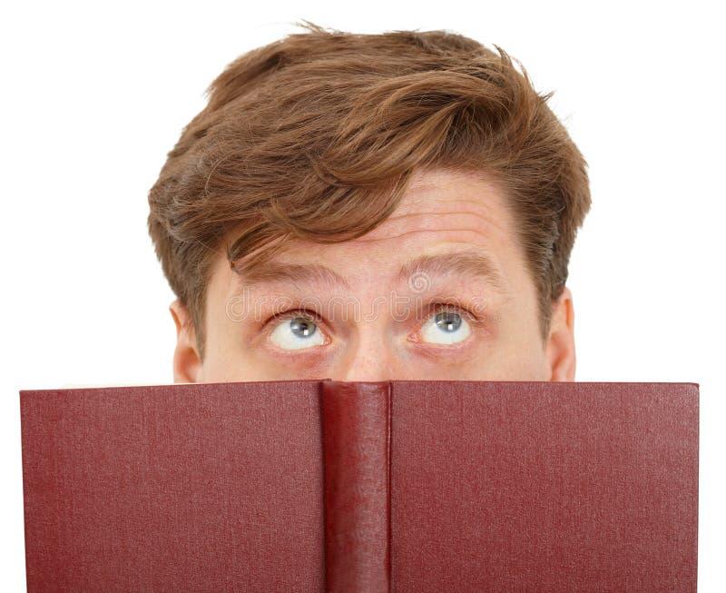 Equipe sonhadora o livro de leitura - close-up dos olhos imagem de stock