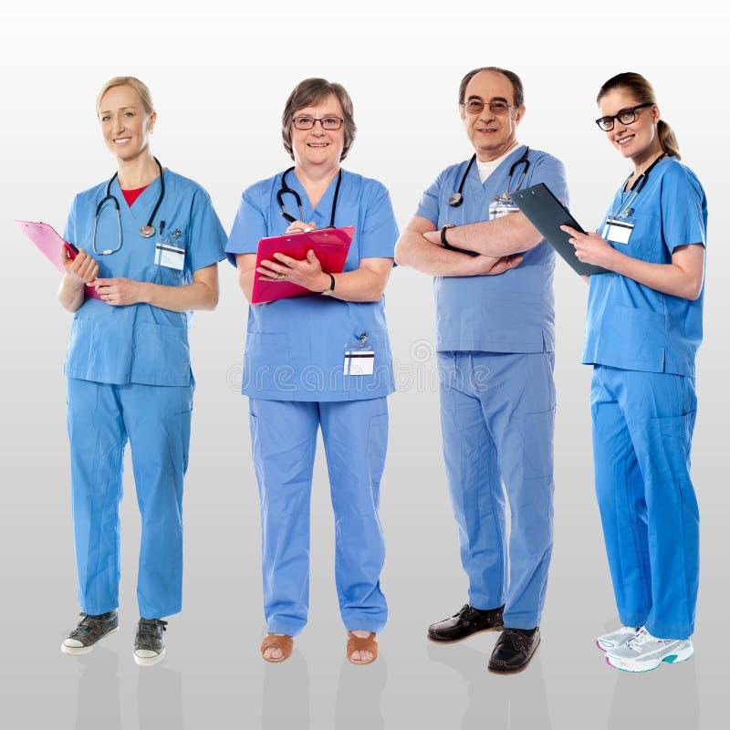 Equipe superior dos doutores que levantam com um sorriso fotografia de stock royalty free