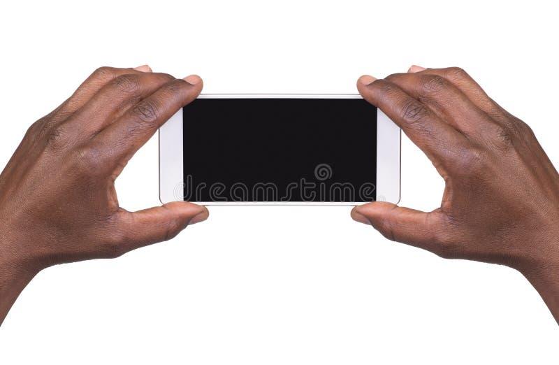 Equipe a tomada de uma imagem usando um telefone esperto fotos de stock royalty free
