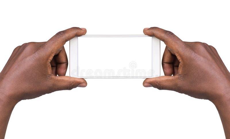 Equipe a tomada de uma imagem usando um telefone esperto imagem de stock royalty free