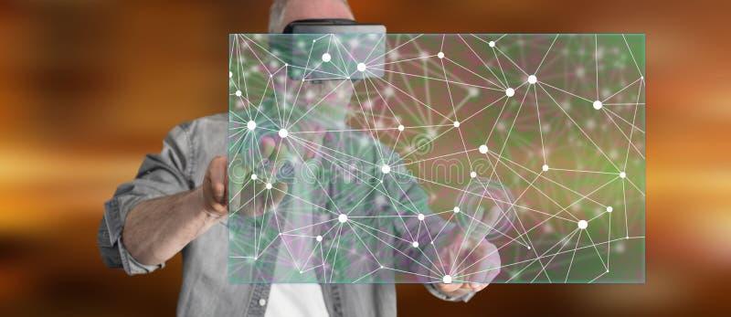 Equipe vestir uns auriculares virtuais da realidade que tocam em uma ilustração da inteligência artificial em um tela táctil fotografia de stock royalty free
