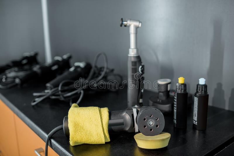 Equipment for automotive body polishing. Professional equipment for automotive body polishing on the table at the car service. Car detailing tools for vehicle royalty free stock images