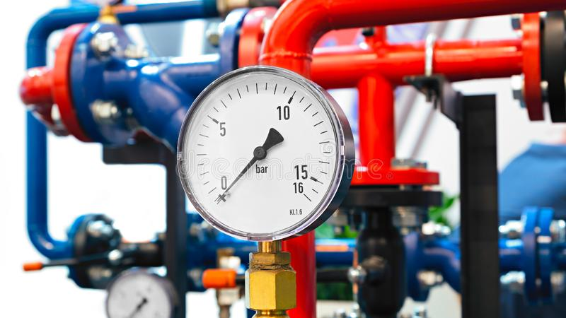 The equipment of the boiler-house, - valves, tubes, pressure gauges, thermometer. Close up of manometer, pipe, flow meter, water p royalty free stock images