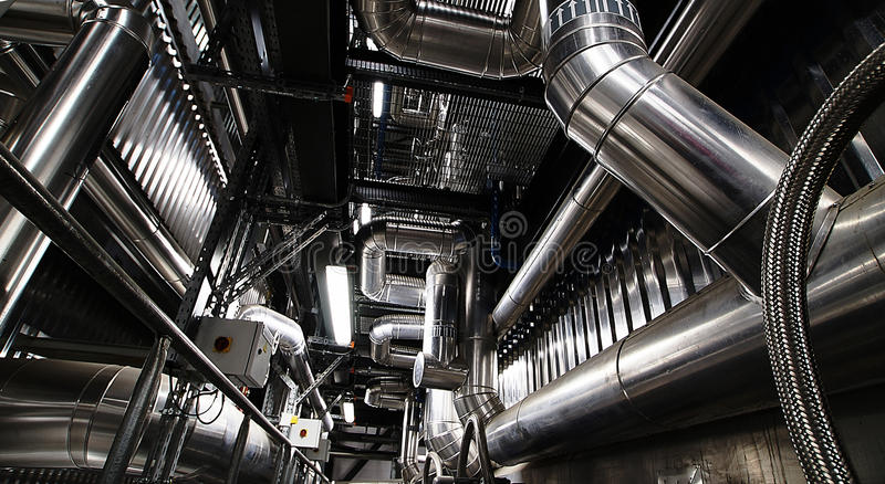 Industrial zone, Steel pipelines and equipment. Equipment, cables and piping as found inside of a modern industrial power plant stock photography