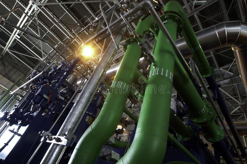 Industrial Steel pipelines, valves, cables and walkways royalty free stock photography