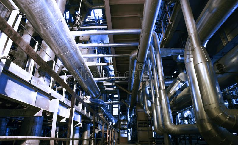 Industrial Steel pipelines, valves, cables and walkways stock image