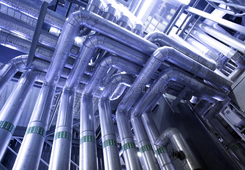 Industrial Steel pipelines, valves, cables and walkways stock photos