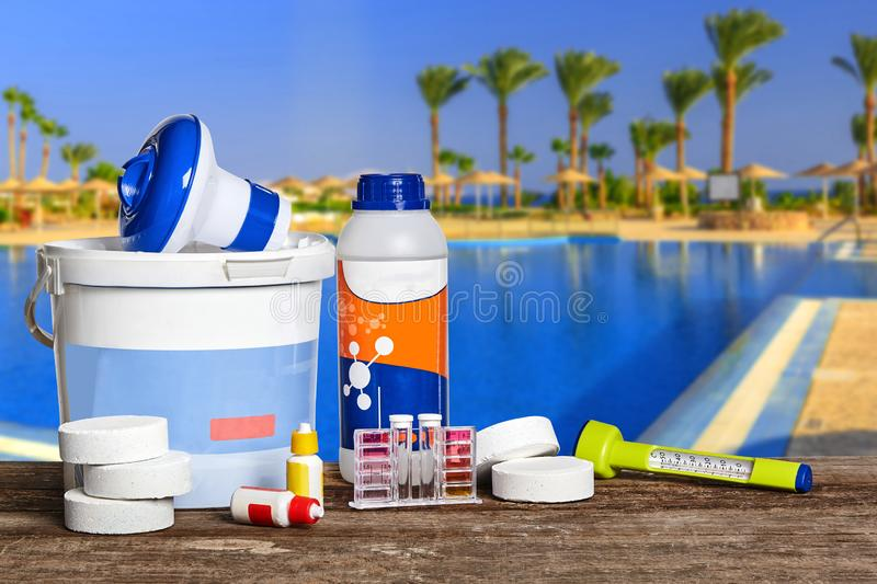 Equipment with chemical cleaning products and tools for the maintenance of the swimming pool. Newfangled equipment with chemical cleaning products and tools for stock photography