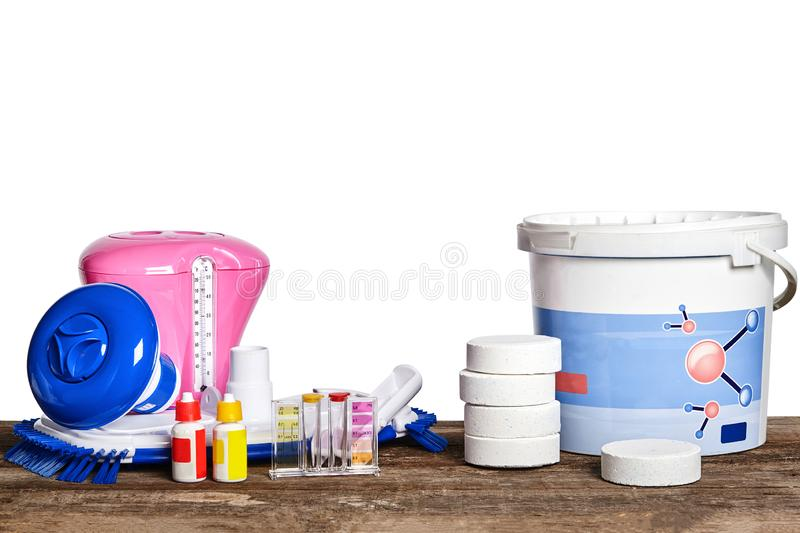 Equipment with chemical cleaning products and tools for the maintenance of the swimming pool on a wooden surface against. High quality equipment with chemical royalty free stock image
