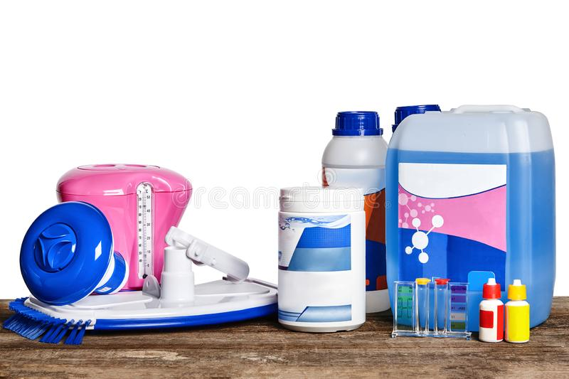 Equipment with chemical cleaning products and tools for the maintenance of the swimming pool on a wooden surface against. Quality equipment with chemical royalty free stock photos