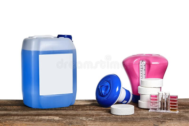 Equipment with chemical cleaning products and tools for the maintenance of the swimming pool on a wooden surface against. Chemical cleaning products, test tubes royalty free stock photo