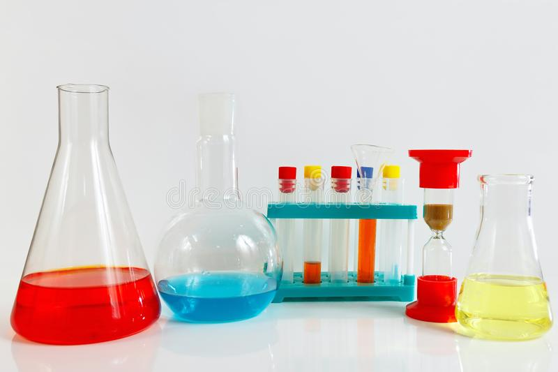 Equipment for chemical experiments on white background. Equipment for chemical experiments on a white background stock image