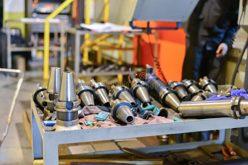 Equipment for the CNC machine tool, drills, cutters, soldering lie on the table near the equipment.  royalty free stock photo