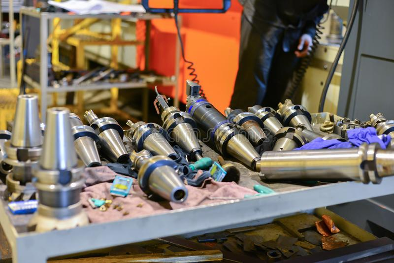 Equipment for the CNC machine tool, drills, cutters, soldering lie on the table near the equipment.  stock photography
