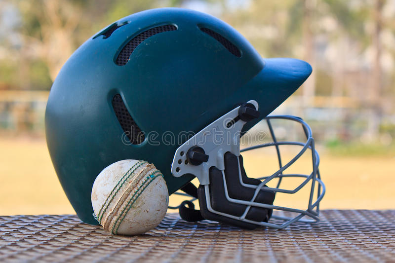 Cricket ball with the helmet stock photo