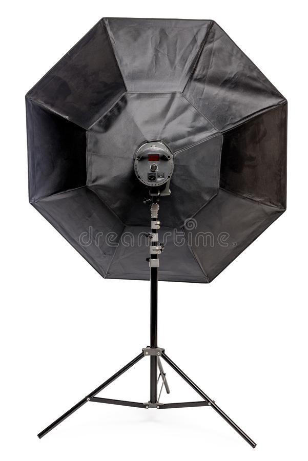 Equipment flash with octagonal softbox on the rack in the studio close-up on a white. Background stock images