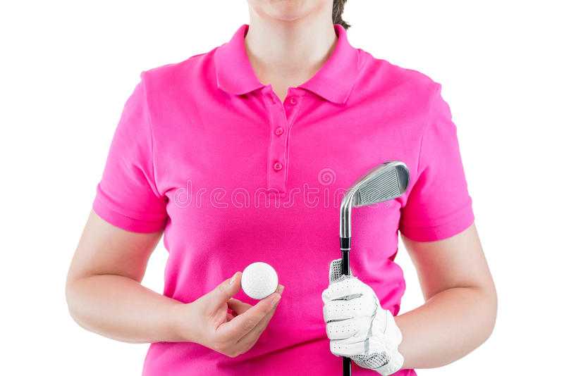 Equipment for golf on the background of a pink Polo T-shirts. In hands closeup stock photos