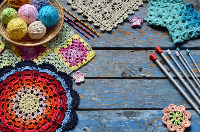 Equipment for knitting and crochet hook, colorful rainbow cotton yarn, ball of threads, wool, knitted elements, napkin . Granny royalty free stock photos