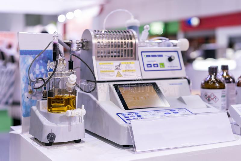Equipment of lab for analysis electrolysis reaction to find concentration of butter sugar cheese paper &. Coluometric titration device of lab for analysis royalty free stock image