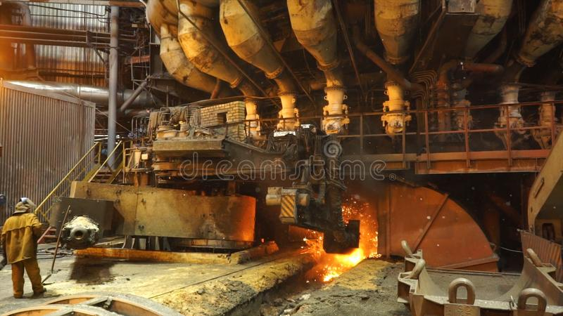 Equipment and machines at the metallurgical plant. Heavy industry. Stationary machines opening.  stock photo