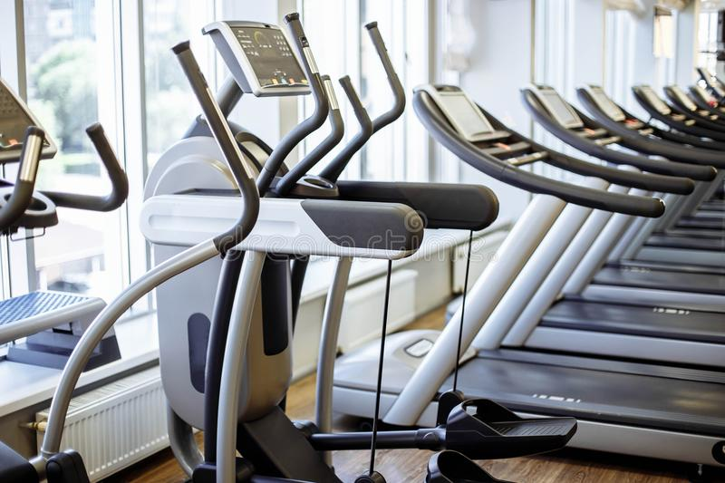 Equipment And Machines At The Modern Gym Room Fitness Center. stock photos
