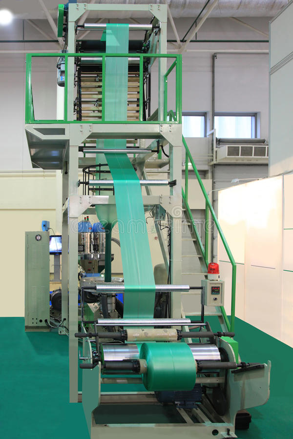Equipment for manufacture plastic bags. Extruder of polyethylene for process production of plastic bags stock photography