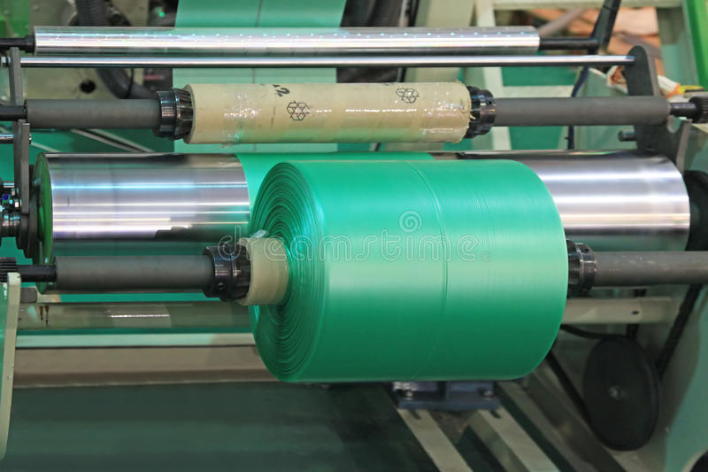Equipment for manufacture plastic bags. Extruder of polyethylene for process production of plastic bags royalty free stock image
