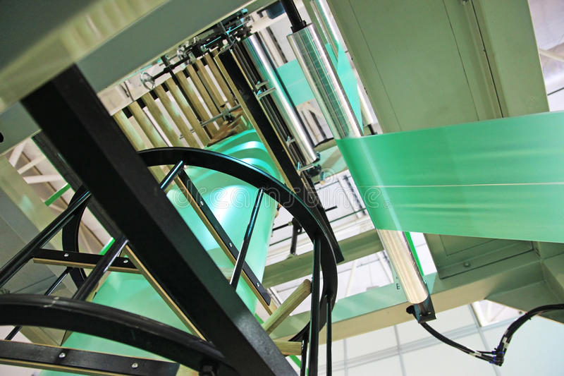 Equipment for manufacture plastic bags. Extruder of polyethylene for process production of plastic bags stock photos