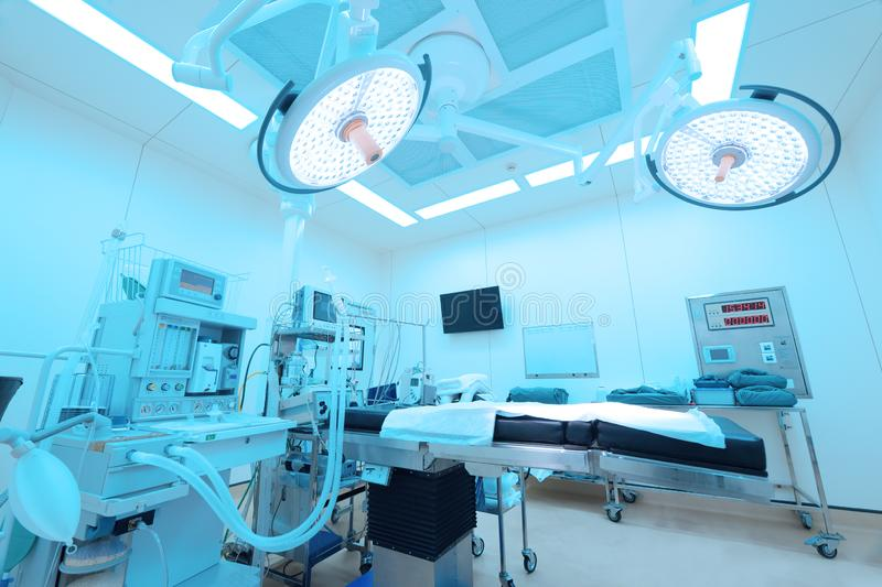 Equipment and medical devices in modern operating room. Take with art lighting and blue filter stock photos